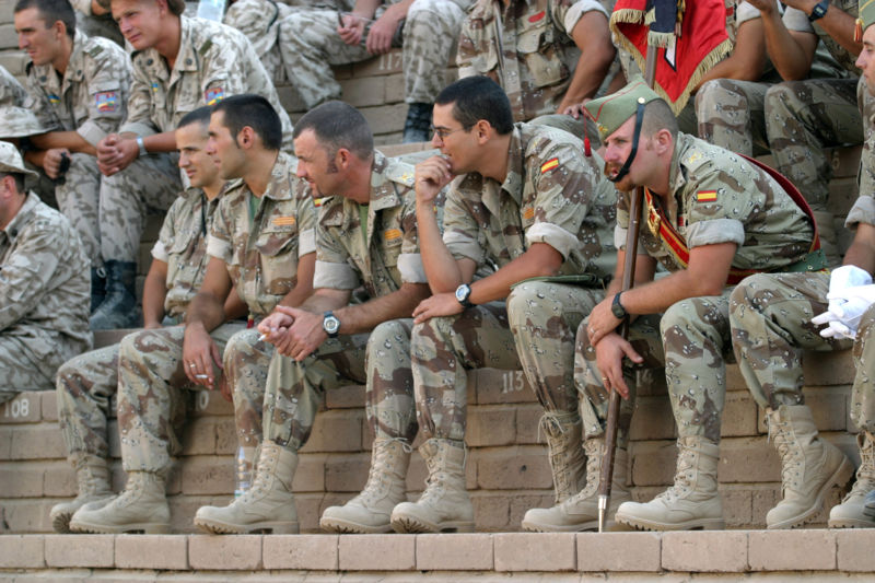 Spanish Army Soldiers (seated front row center) are among the Multinational Coalition Forces on hand to witness the Relief in Place (RIP) Ceremony as US Marine Corps (USMC) Marines assigned to the 1st Marine Expeditionary Force (I MEF) relinquish authority to the Polish lead Coalition Forces, during a ceremony held inside the amphitheater at Camp Babylon, Iraq, during Operation IRAQI FREEDOM.